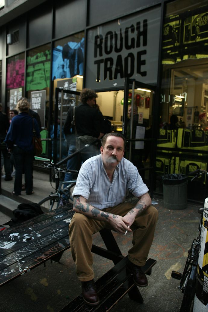 Andrew Weatherall sat outside Rough Trade East
